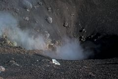 Steam and toxic gases emanating from the Etna volcano crater. In Sicily Royalty Free Stock Photo