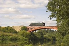 Steam Train. A steam locomotive from the Severn Valley Railway crosses Victoria Bridge in Worcestershire, UK Stock Photos