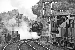 Steam train. Vintage old steam train on rail tracks in black and white Royalty Free Stock Photos