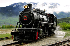 Steam train. An old, black steam engine Royalty Free Stock Photo