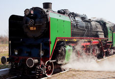 Steam train. View of steam train leaving from a station platform Stock Image