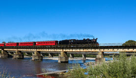 Steam Train. Cross over a railway bridge Royalty Free Stock Image