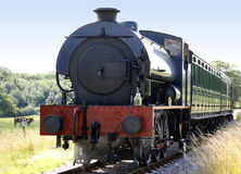 Steam Train. IOW steam train WD198 'Royal Engineer' pulling passenger Carriages Stock Photo