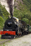 Steam Train. A steam locomotive leaving the station Stock Photos