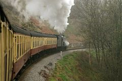 Steam train. A steam train pulling up against the platform Stock Photo
