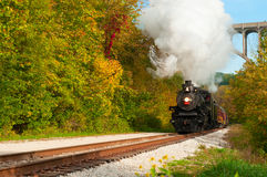 Steam train approaching. Brecksville, OH - September 29, 2012: A vintage steam engine makes a special excursion on the Cuyahoga Valley Scenic Railroad through Royalty Free Stock Photography