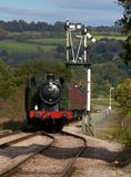 Steam Train Approaching. Steam Train crossing signal in the English countryside Royalty Free Stock Image
