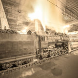 Steam train arrives to the station at night time. Royalty Free Stock Photo