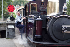 Steam train arriving. Steam train ride in wales, arriving at a stop Stock Images
