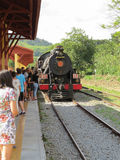 Steam train arriving at the small train station. With passengers disembarking in the countryside of Brazil, Luís Carlos Town Royalty Free Stock Images