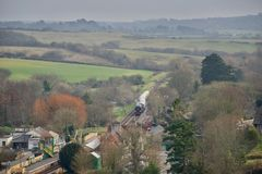 Steam train arriving at station in countryside royalty free stock photos