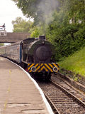 Steam train arriving. At the station at East Lancashire 40's weekend, Lancashire, UK royalty free stock image