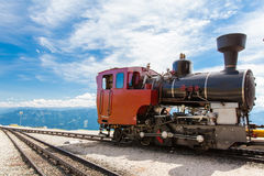 Steam train in a beautiful alpine landscape. Royalty Free Stock Photo