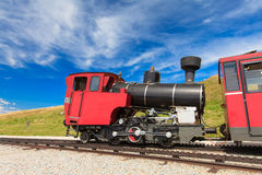 Steam train in a beautiful alpine landscape. Stock Photo