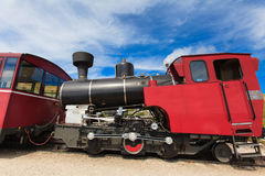 Steam train in a beautiful alpine landscape. Royalty Free Stock Images