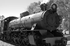 Steam train in black and white. Blowing smoke Royalty Free Stock Images