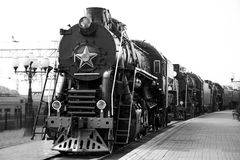 Steam train black-and-white. Old russian steam train at station. Black-and-white Stock Image