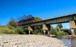 Steam Train Bridge. Steam train cross over a railway bridge Stock Image