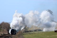 Steam train 35018 British India Line on test run. Preserved steam locomotive British India line, number 35018, on a mainline test run on Wednesday 7th March 2018 Royalty Free Stock Image