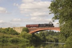 Steam Train and Carriage. A steam train and carriage from the Severn Valley Railway crosses Victoria Bridge over the River Severn in Worcestershire, UK Stock Photos