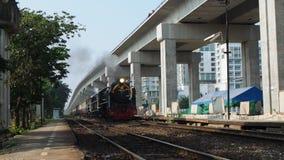 Steam train on Chulalongkorn Day. BANGKOK, THAILAND - OCTOBER 23, 2015: A steam train enters Laksi railway station on Chulalongkorn Day on October 23, 2015 in stock video