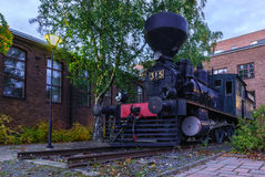 Steam train in the city. Royalty Free Stock Photo