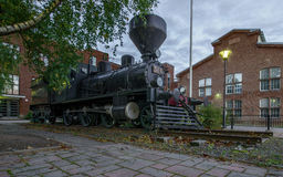 Steam train in the city. Stock Images