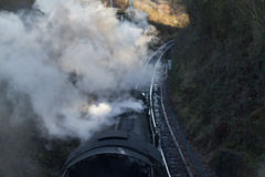 Steam train on a cold day. A steam train passing under the camera on a cold crisp sunny day Stock Image