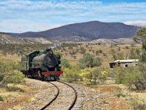 Steam train coming around the corner royalty free stock image