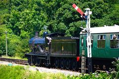 Steam train at Corfe Railway Station. stock images