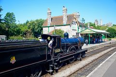 Steam train at Corfe Railway Station. royalty free stock photography