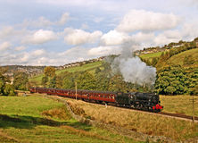 Steam train in countryside. Steam train travelling through countryside, Haworth, West Yorkshire, England Stock Photos