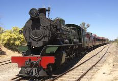 Steam train crossing lines Stock Photo