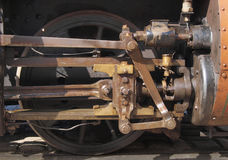 Steam train detail. Detail of wheel driving mechanism on steam train royalty free stock photo