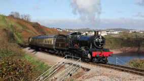 Steam train on the Devon coast near Paignton. PAIGNTON, DEVON, UK-NOVEMBER 5TH  2016: Beautiful late autumn weather was enjoyed by passengers on a steam train on stock video footage