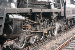 Steam Train Drive Wheels. Building up steam ready to depart Stock Images