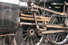 Steam Train Drive Wheels. Building up steam ready to depart Royalty Free Stock Photography