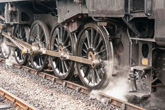 Steam Train Drive Wheels. Building up steam ready to depart Royalty Free Stock Images