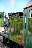 Steam train and engine driver. Stock Image