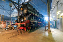 Steam train engines. LJUBLJANA, SLOVENIA - JUNE 20th 2015: Yugoslav president's Tito seam train engines parked in the railway museum workshop stock photo
