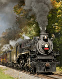 Steam Train through Fall Foliage Stock Images