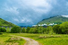 Steam train on Glenfinnan viaduct, known from Harry Potter Royalty Free Stock Image