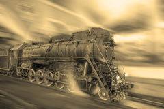 Steam train goes fast on the night station background. Royalty Free Stock Photography