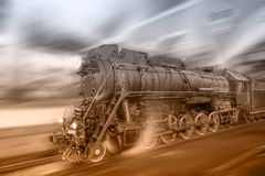 Steam Train Goes Fast On The Night Station Background. Royalty Free Stock Images
