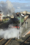 Steam train leaving station. Caledonian steam train leaving old station platfor Stock Photo