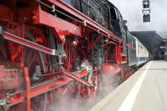 Steam train leaving the station Royalty Free Stock Photography