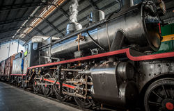 Steam train leaving the station. Steam locomotive in an ancient train in Spain about to leave the station Stock Photography