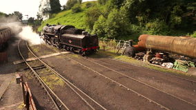 Steam train leaving yard B stock video footage