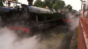 Steam train leaving yard A stock footage