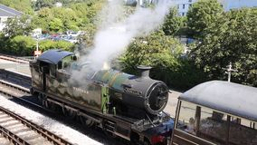 Steam Train letting off steam in the station. Green Steam Train engine letting off steam in the station stock footage